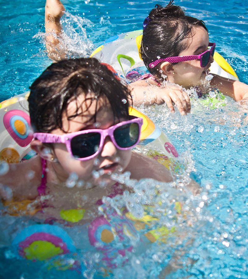 Kids playing in a pool.